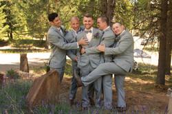 grooms men hugging