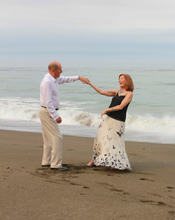 couple dancing on the beach portrait