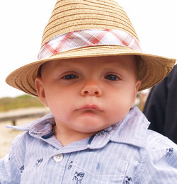 baby boy in a panama hat