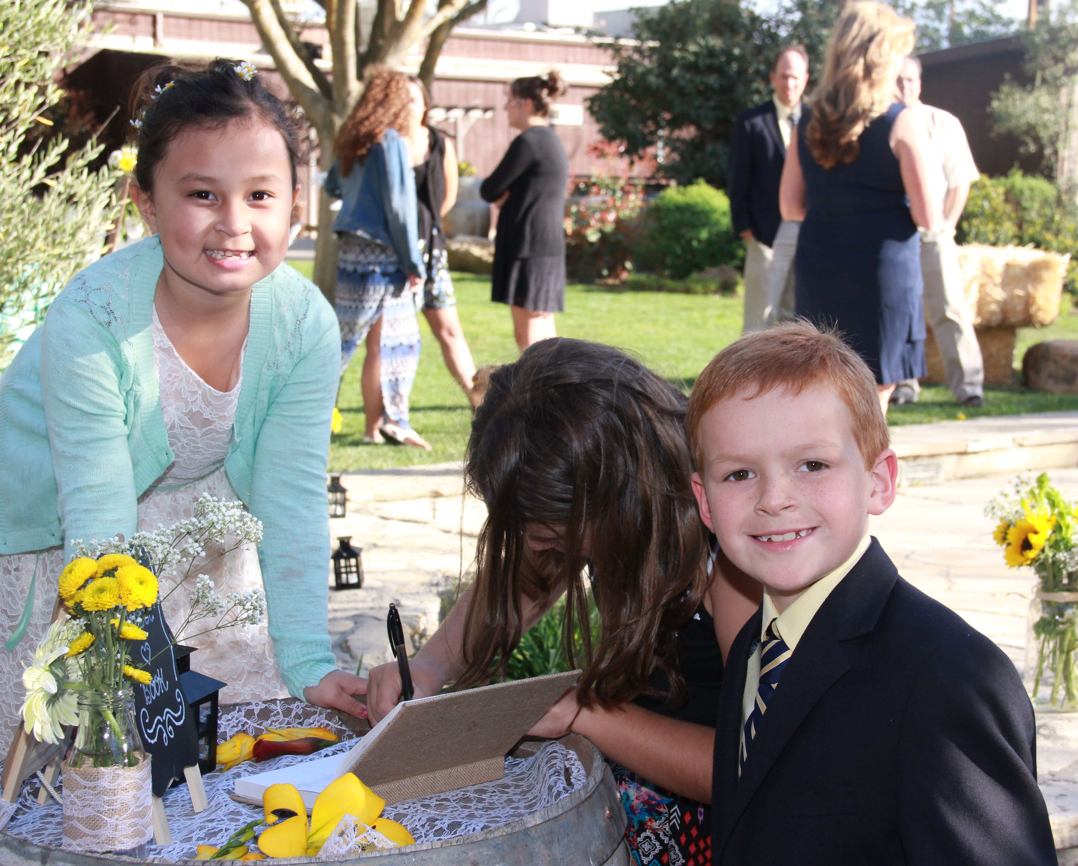 children signing the guest book