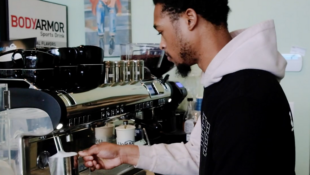 A barista prepares a drink behind the counter at UnBAR Cafe in Cleveland, Ohio
