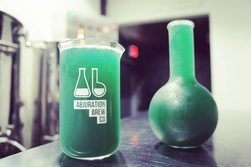 Blue Razz Brew from Abjuration Brewing in beakers