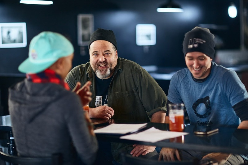 Owners Dave and Tom of Abjuration Brewing laugh while sitting at a bar