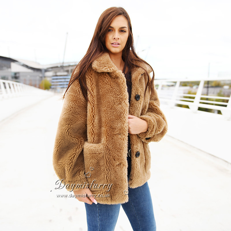 Chic and warm in winter season. 100% sheep wool Oversize style with lapels Satin lining Low set-in sleeves Features zip front with 2 deep pockets Length measures 26.5 inches. Care instructions: dry clean and professional fur clean only Brand: DAYMISFURRY