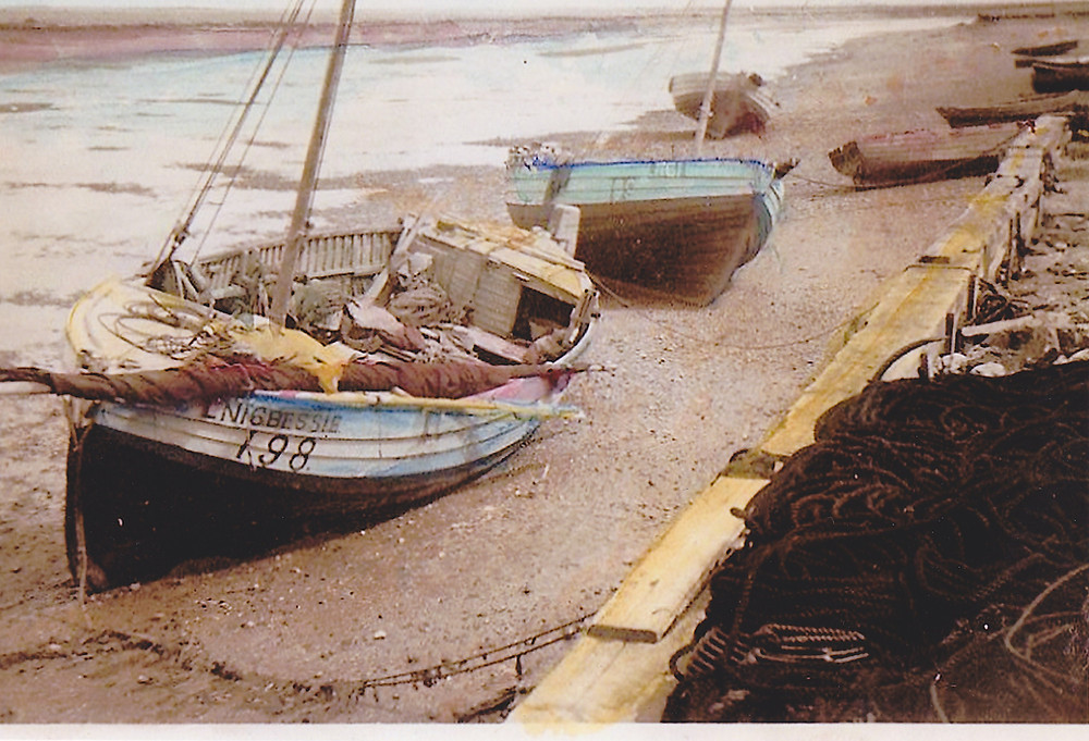 Bessie a whelker boat is moored in Wells-next-the-Sea  in the 1930s