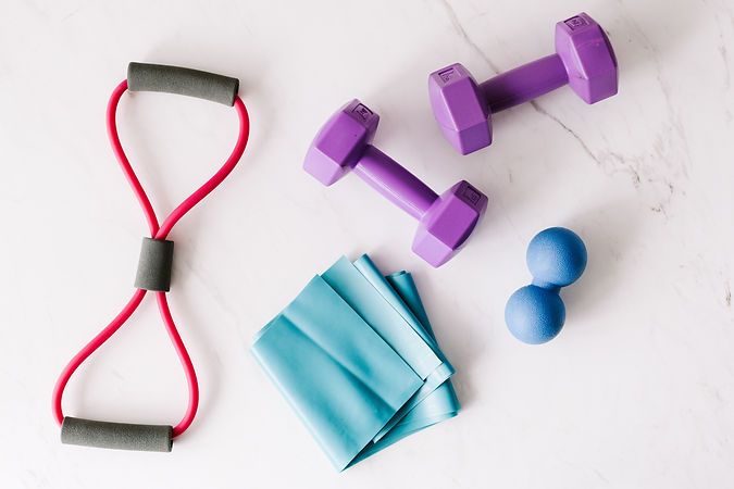 set-of-fitness-equipment-placed-on-marbl