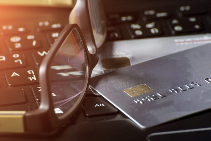 Credit card with glasses on laptop