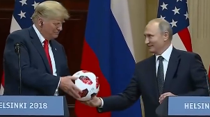 President Putin exchanges soccer ball with President Trump