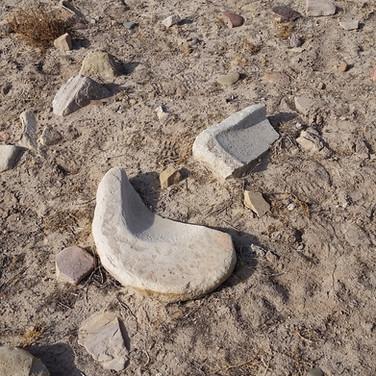 Broken sandstone metate.