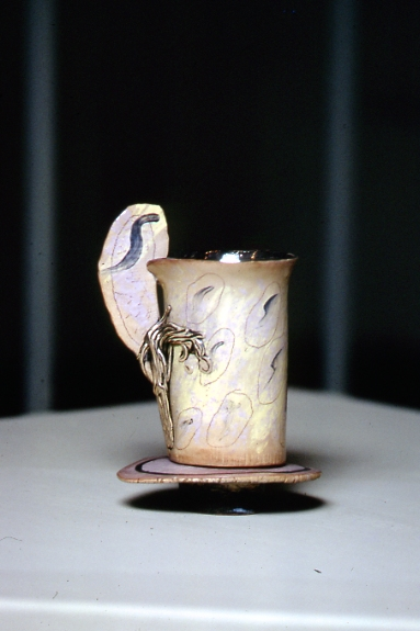 Winged cup on stand