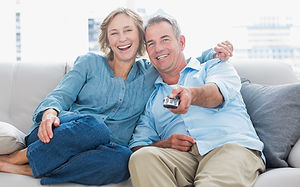 Couple using a TV remote