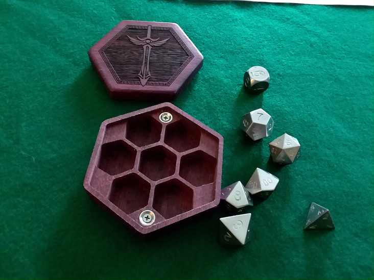 Lucan dice of tungsten steel.  They are glorious!  Also, thanks Aaron for the glorious dice!