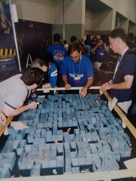 Casey, Aaron, and Mark checking out this giant Mage Knight Dungeon setup.