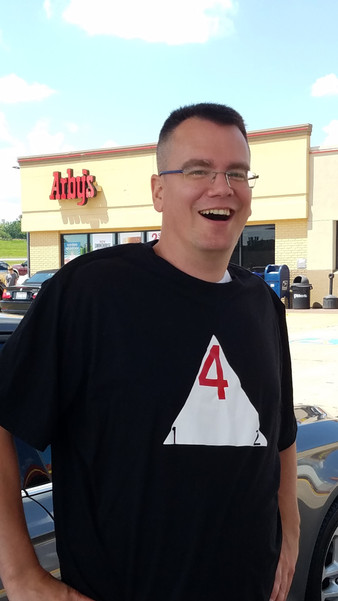 Gen Con 2018.  Hudson going all out.  Homemade d4 on the Floor shirt and stopping at Arby's.