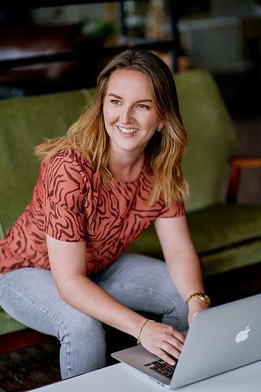 Roxanne Deurloo, Leading Light, on sofa working on laptop