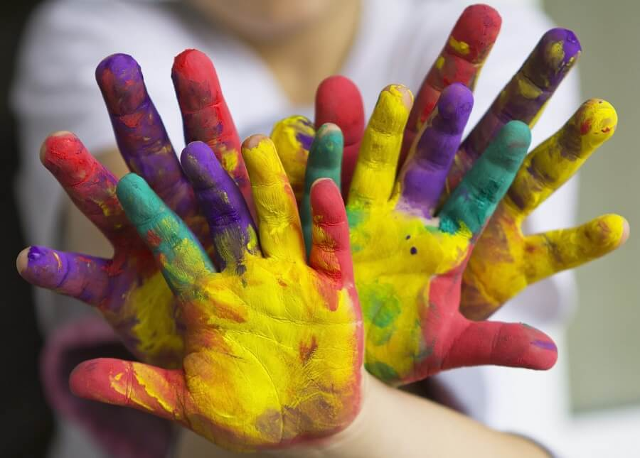 1_child-hands-covered-in-paint