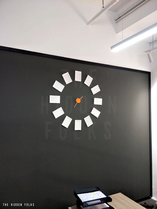 Photo frame clock set for Bespoke Builders Pte Ltd.