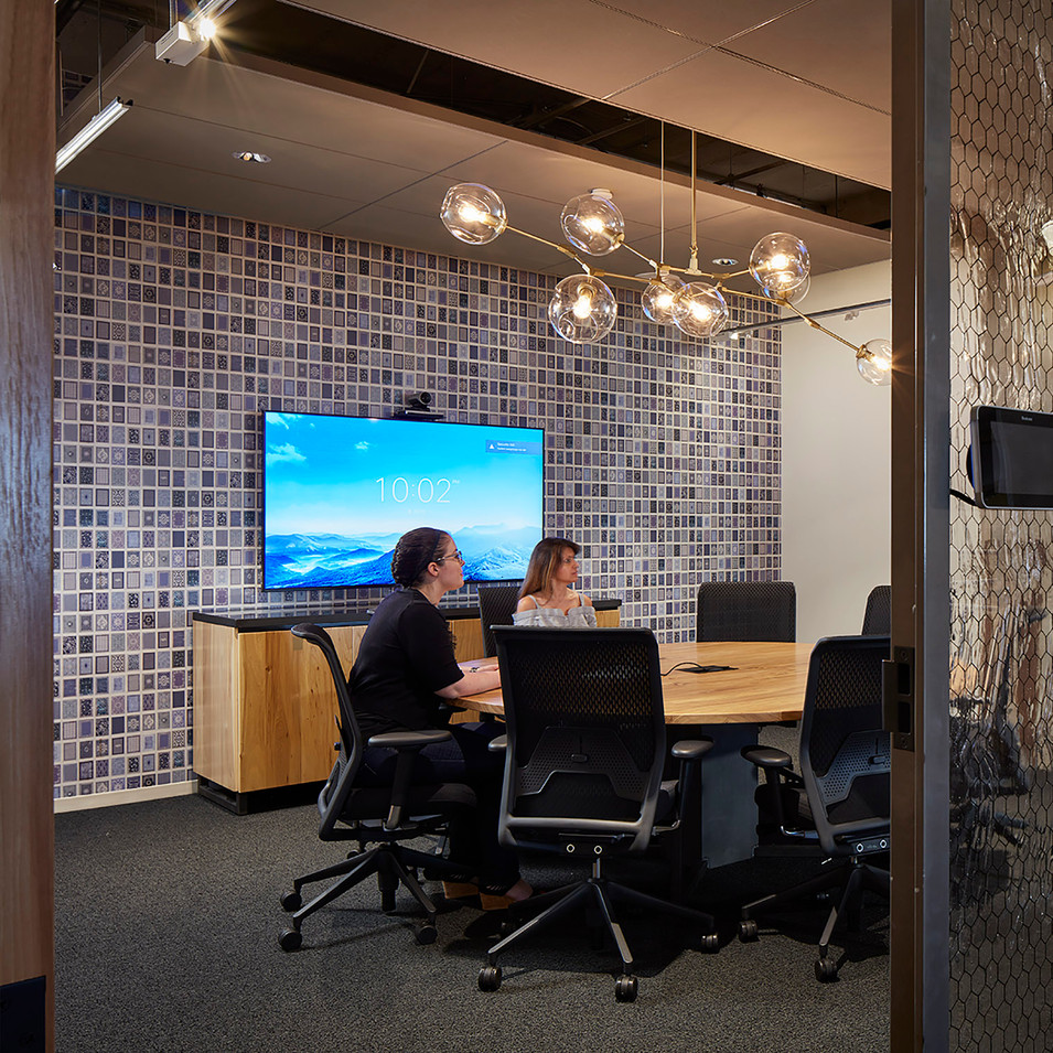Conference Room with Exposed Brick and Brass Chandelier in Confidential Chicago Financial Firm by Kuchar Studio