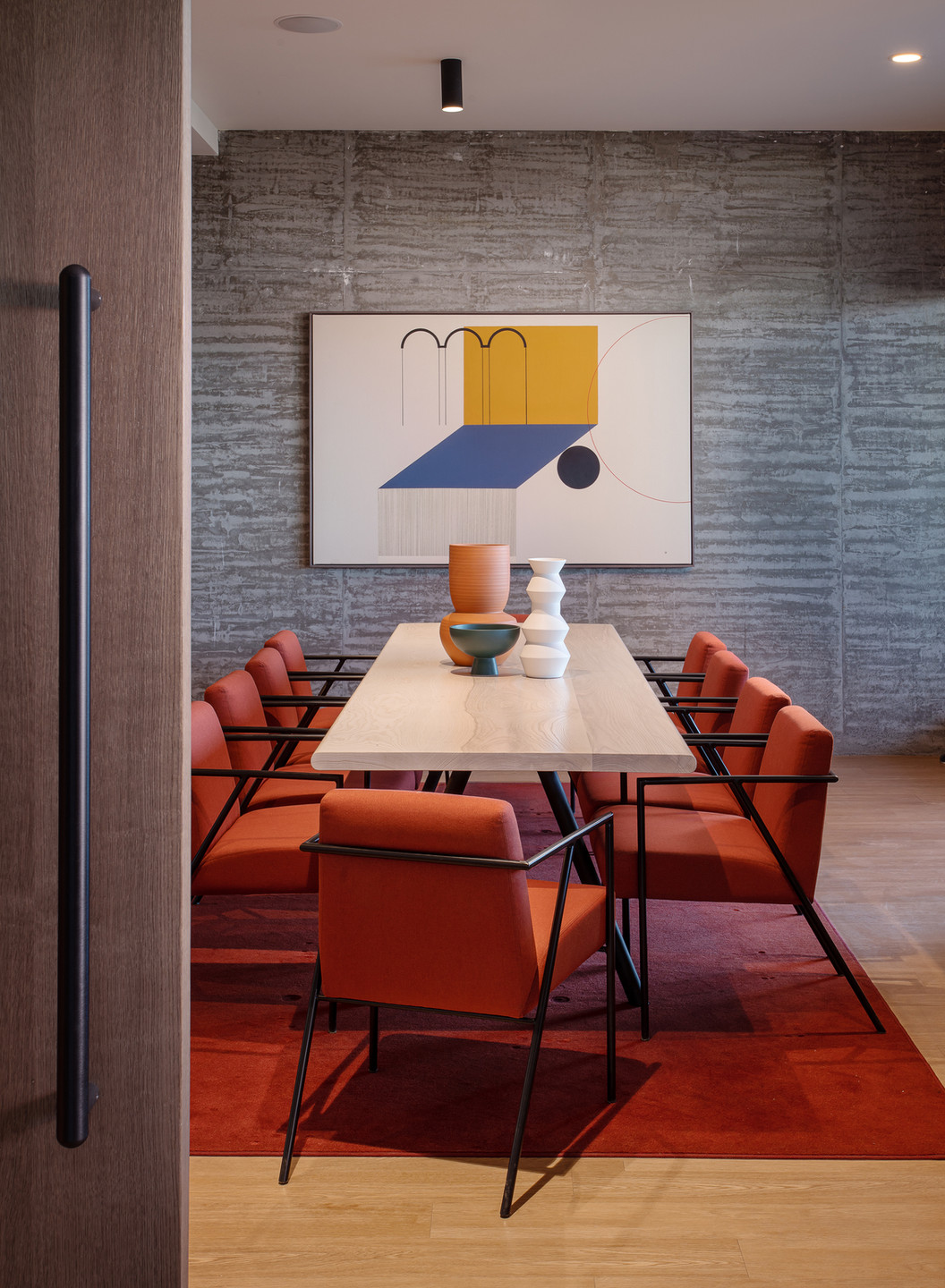 Community dining room featuring art by Dani Hacche