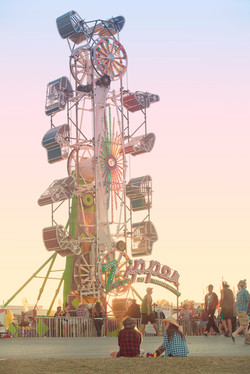 Amusement ride at sunset