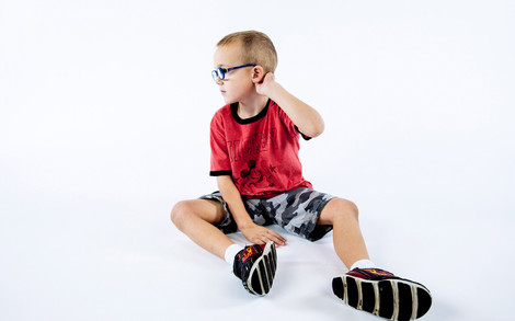 Young boy in red with Epilepsy.