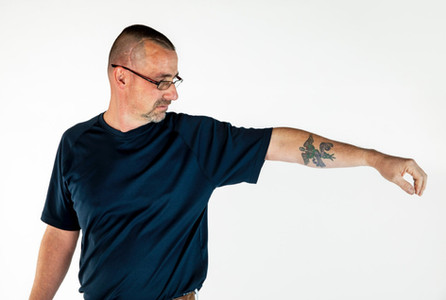 Man with epilepsy shows his tatoo.