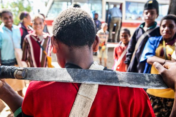 Boy in Papua New Guinea with machette
