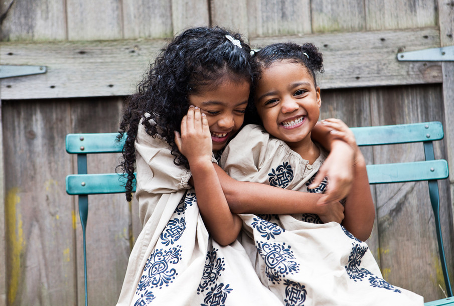 Sisters laughing.
