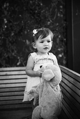 Girl holding a stuffed animal.