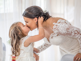 Bride and Daughter Wedding Kiss