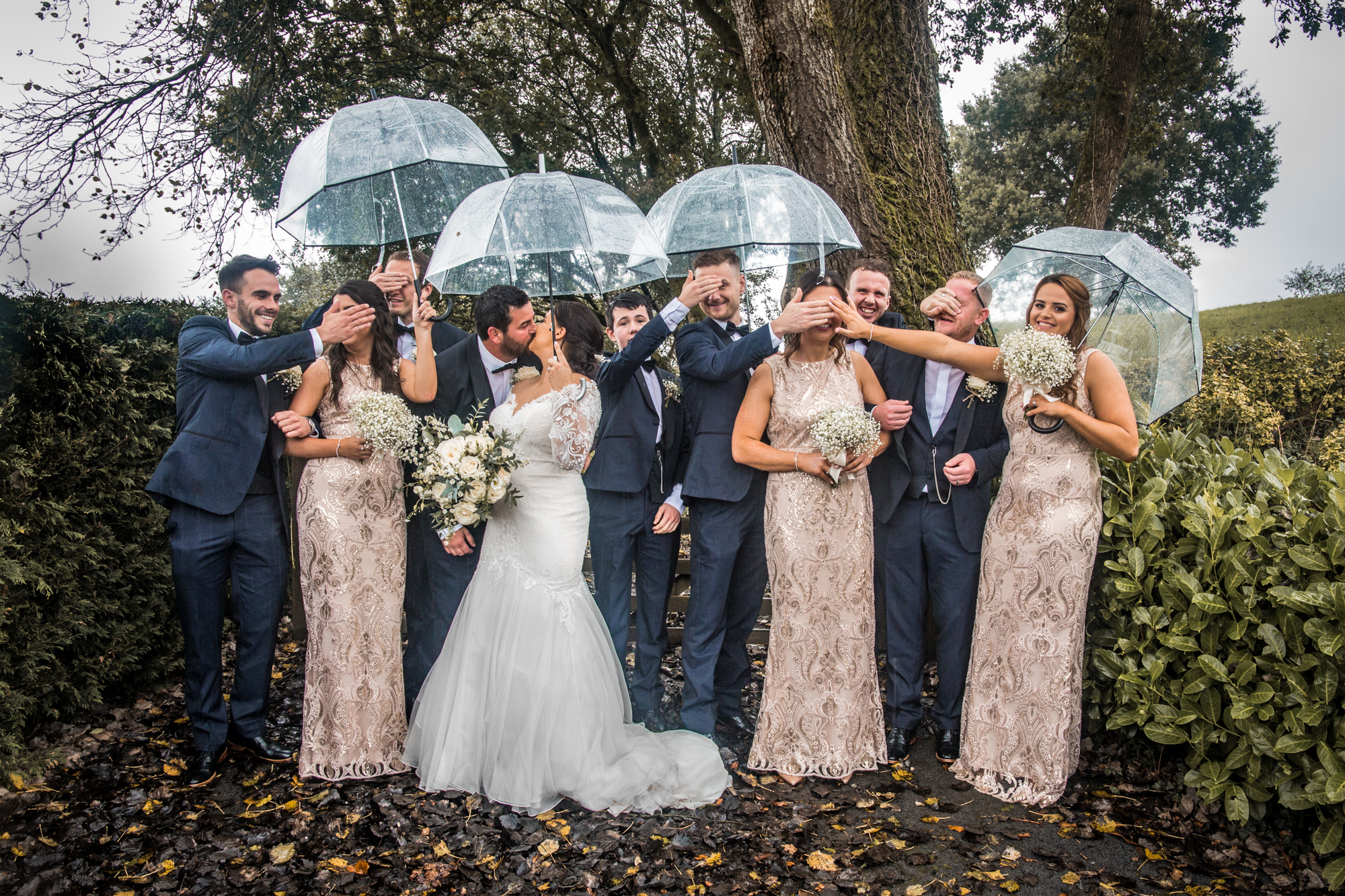 Rain and umbrella Wedding Photography in Swansea and the Gower