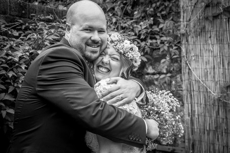 newly wed embrace each other in south wales