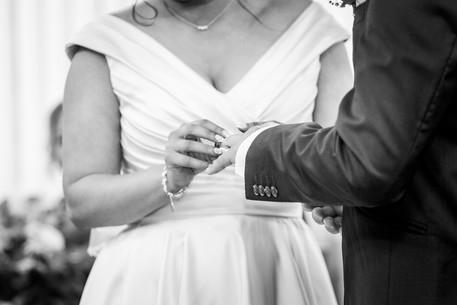 bride exchanges wedding rings photographed in swansea registrars