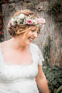 natural and relaxed wedding photography as bride smiles on