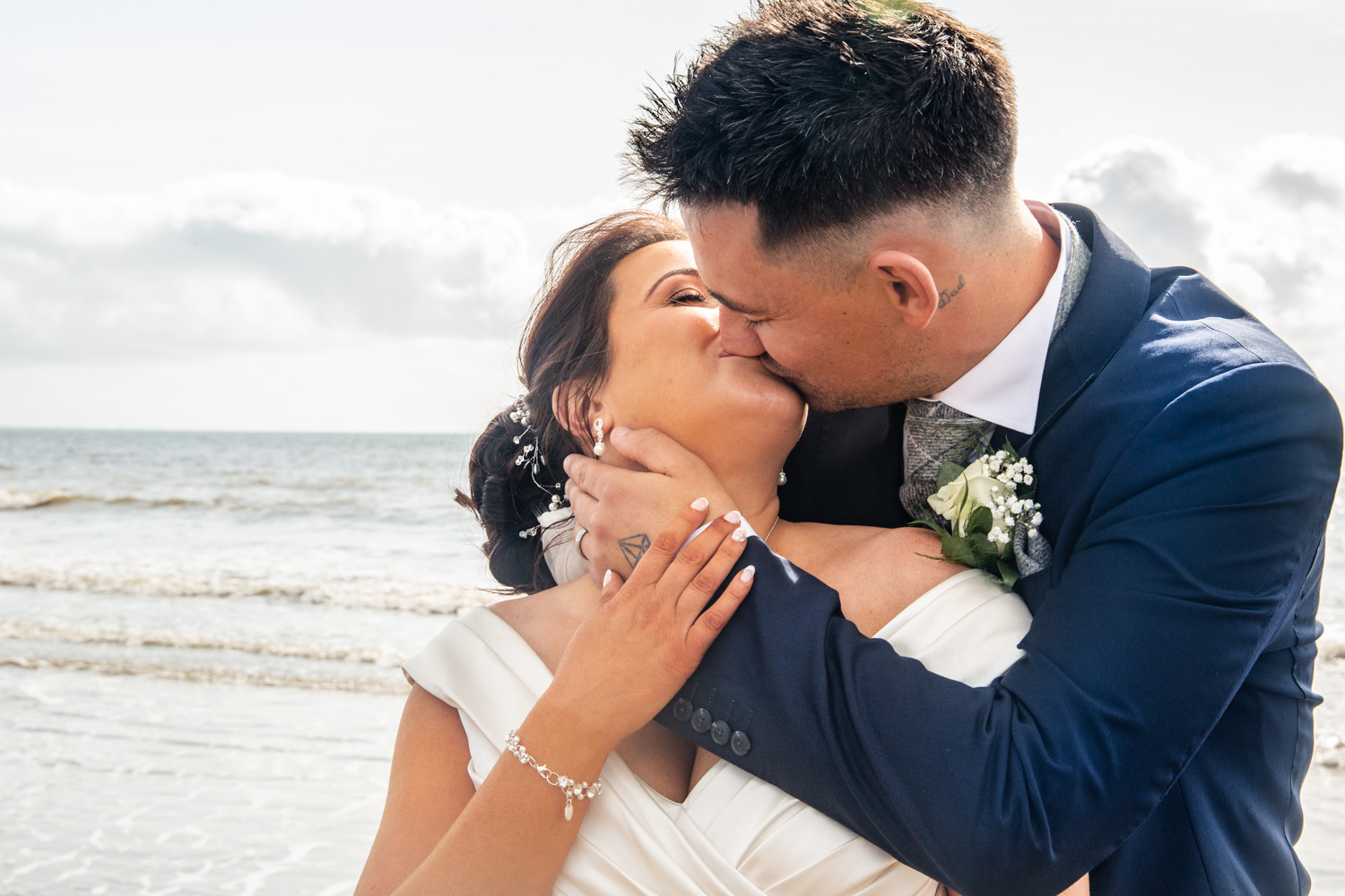 best wedding photography kiss of bride and groom in swansea and gower beach