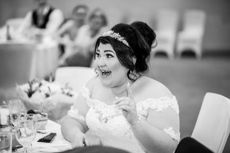 Bride laughing to the Speech at Stradey Park Hotel Llanelli, Carmarthenshire Wedding Photography