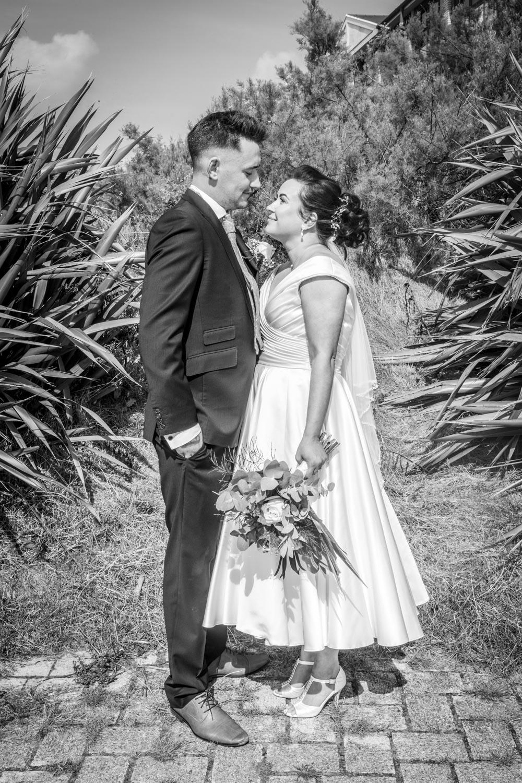 couple posing for swansea based wedding photographer