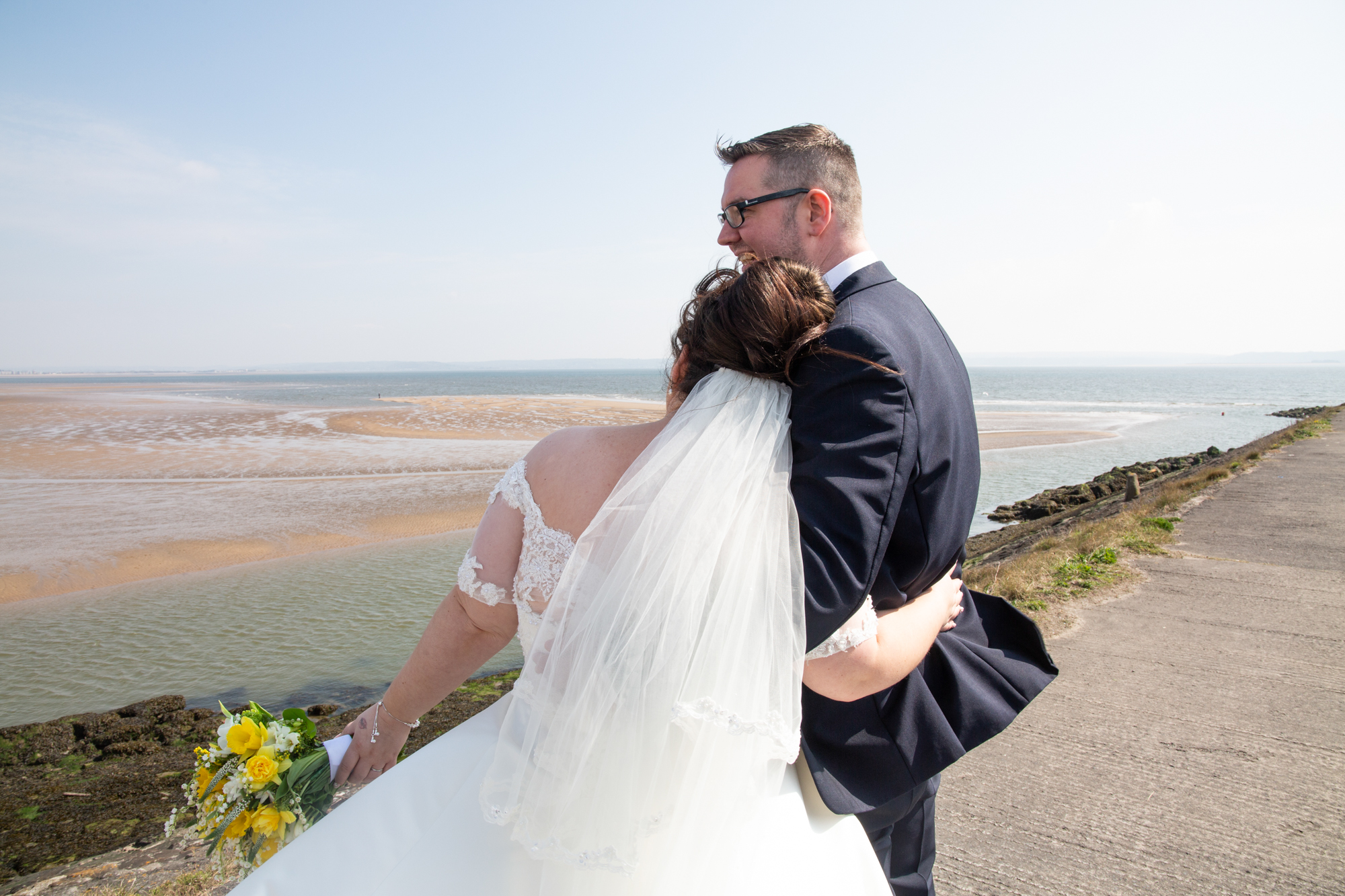 Burry Port Wedding Photography Bride and Groom Portrait. Photographer covering The Gower, Carmarthenshire, Llanelli, South Wales and Bridgend