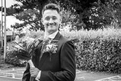 groom and bouquet in swansea bay