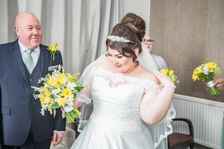 Natural Wedding Photography in Swansea, Carmarthen and The Gower of Bride's Dress and tweaks