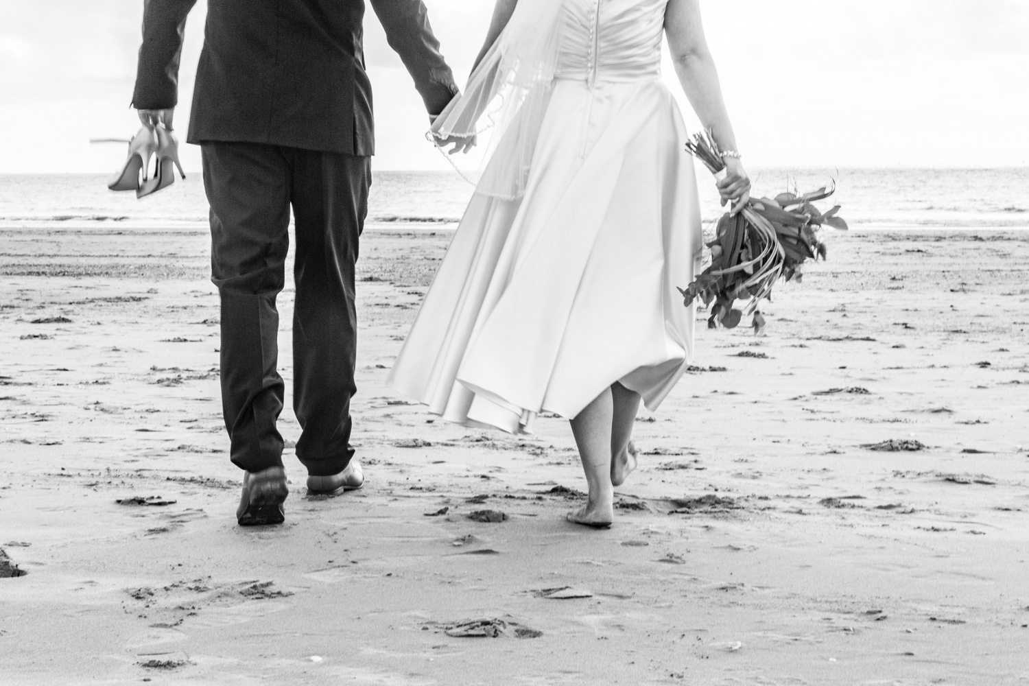 beautiful beach wedding photography in swansea with bride and groom