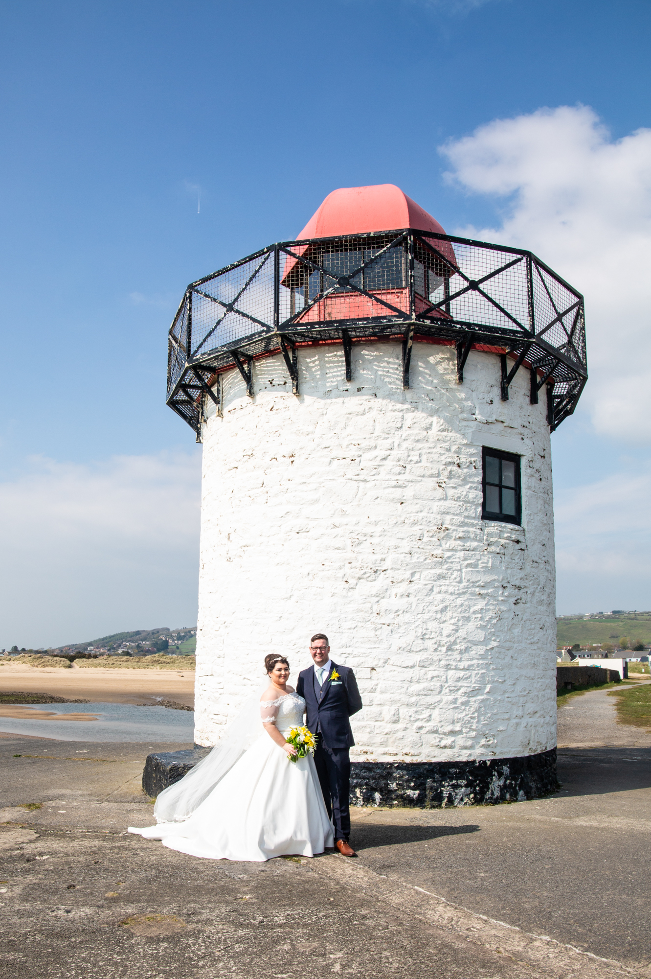 Burry Port Lighthouse Wedding Photography Bride and Groom Portrait. Photographer covering The Gower, Carmarthenshire, Llanelli, South Wales and Bridgend