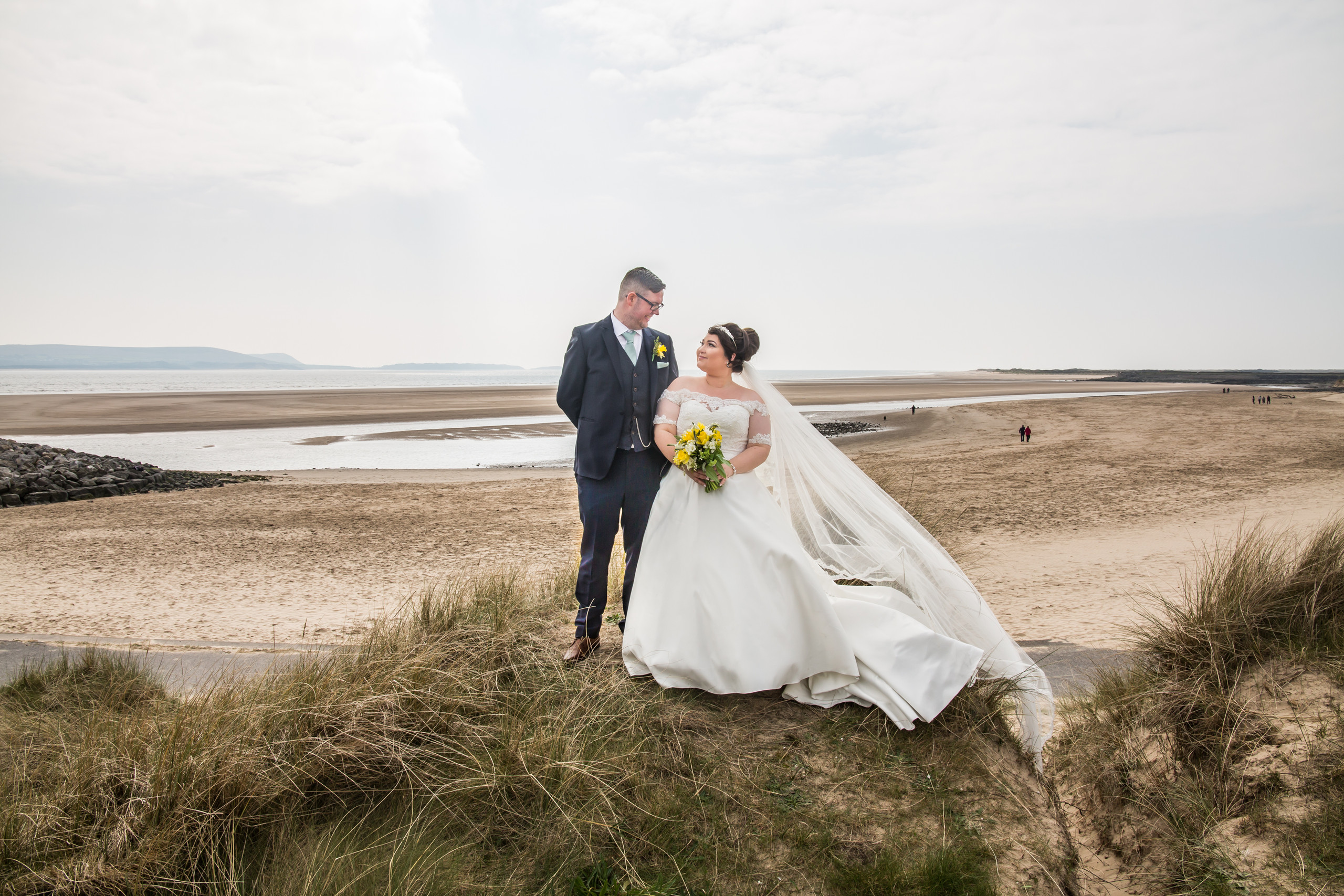 Bride and Groom Photography with the Gower and Swansea Beach behind
