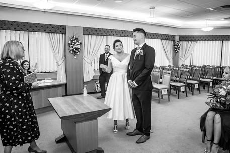 bride accepts marriage certificate from swansea registrar