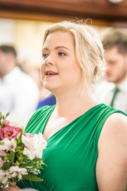 bridesmaid singing in a swansea church during the ceremony