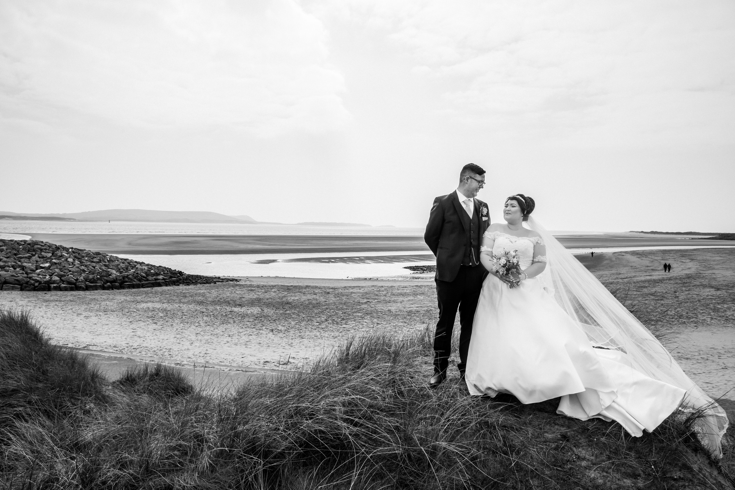 Bride and Groom Photography with the Gower and Swansea Beach backdrop