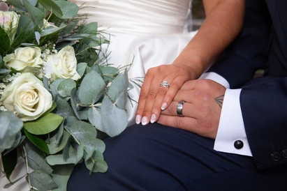 close up photography of bride and grooms swansea wedding rings
