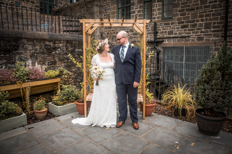 natural and relaxed wedding photography of bride and groom in swansea venue