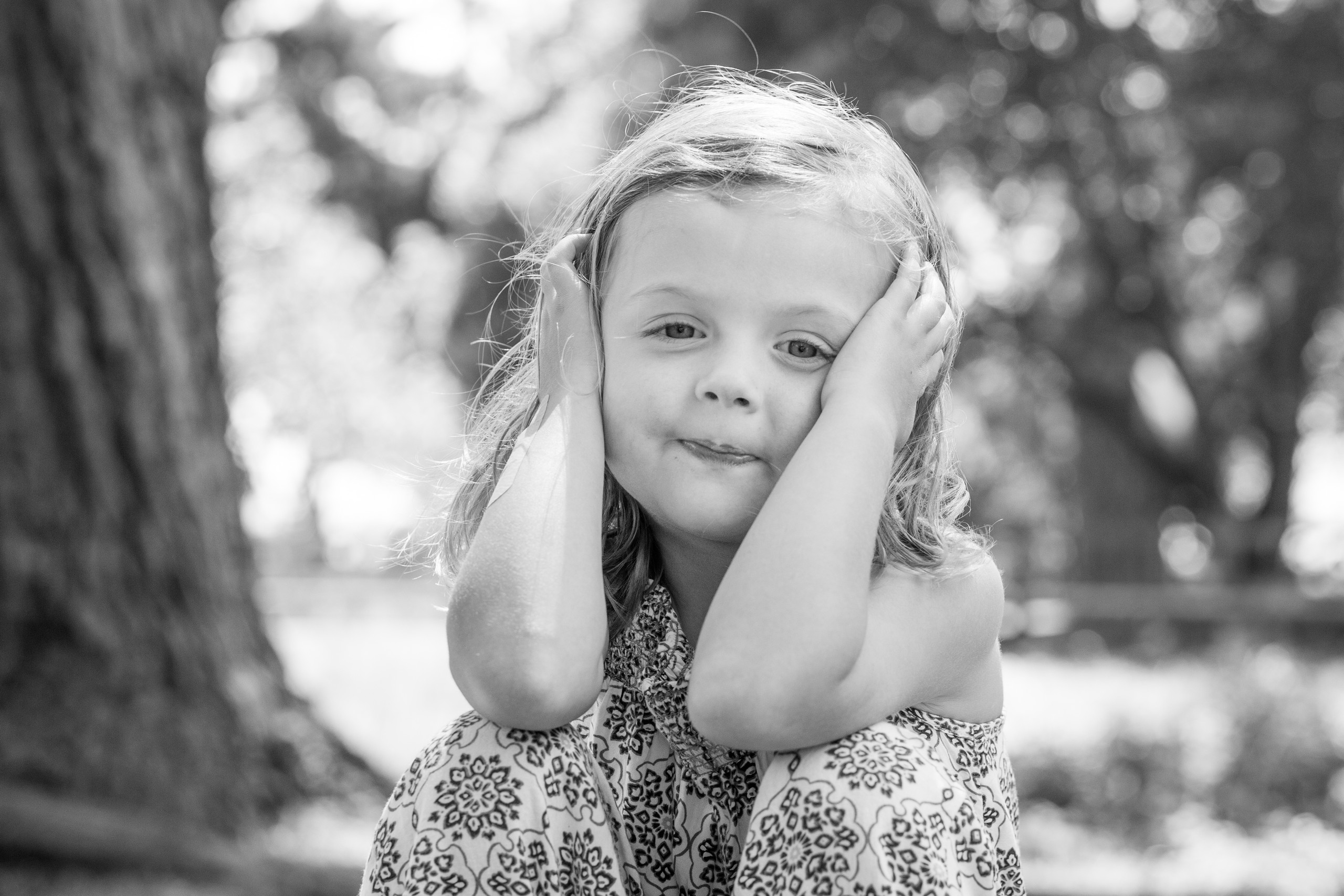 toddler in a contemplative mood has her photo taken in swansea