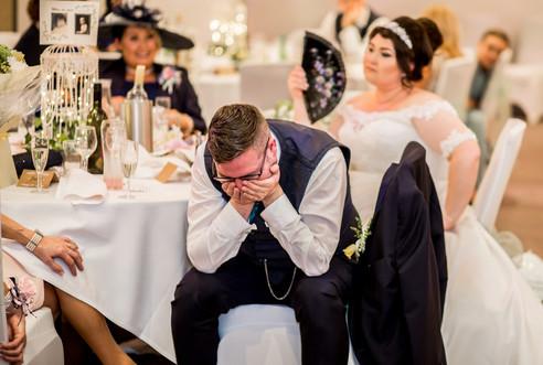 Groom listening to Speech at Stradey Park Hotel Llanelli Wedding Photography